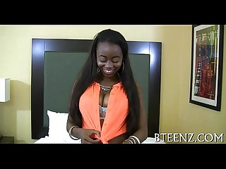 Ebony beauty rides on a white knob
