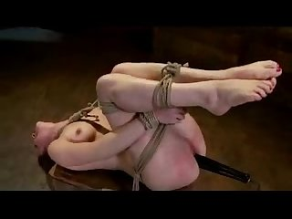 Hogtied girl clips on nipples vibrator in her pussy getting mouth and pussy fucked with toys by the