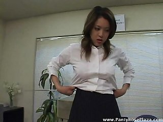 Bored Secretary exercises while teasing at The same time by licking her feet