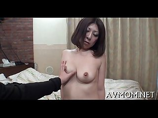 Milf pokes pussy with sex toy