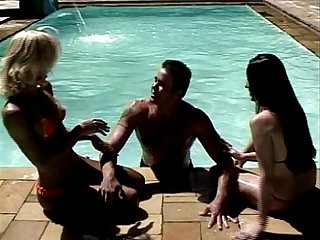 Two randy shemales and guy in pool
