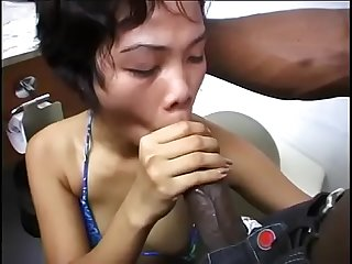Young Filipina girl sucks BBC on the toilet
