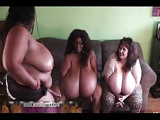 2 black and 1 white women with huge tits play with oil and a dildo