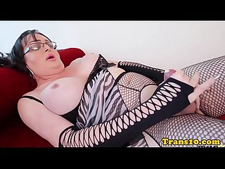 Shemale in sexy lingerie toying her ass
