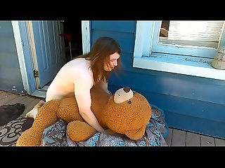 Sissy boy fucking her teddy bear outside