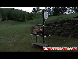 Outdoor bdsm cage locked enema slave