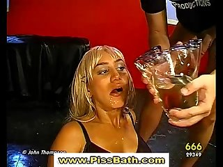 Real blonde drinks piss and gets a goldenshower i gangbang