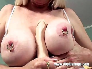 Blonde mature big pierced tits and snatch