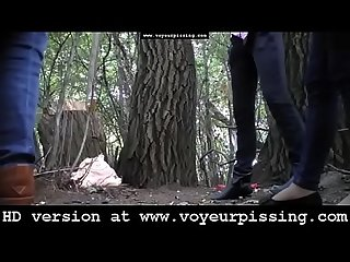 www.voyeurpissing.com - Hidden camera near a tree films ladies pissing outdoor