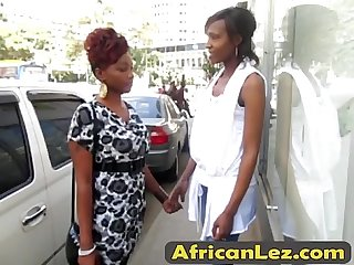 Slutty African girls shower together and finger their pussies