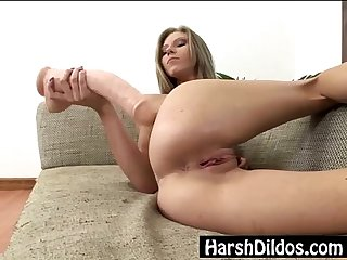Petite blonde pounding two big dildos