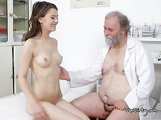 Gejza moans loudly while rubbing her clit then he sprays his jizz on her tits