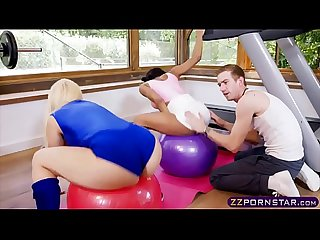 A personal trainer fucks his two sexy client in the ass