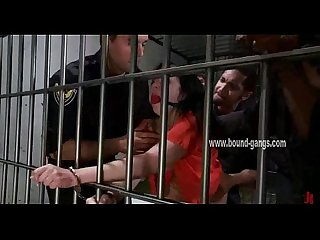 Gagged brunette inmate gets her ass aggressively fucked by a bunch of horny cops