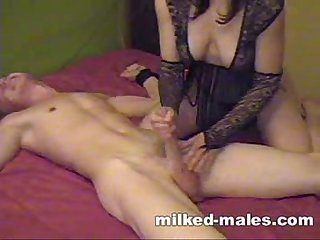 Gorgeous girl milking tied boy