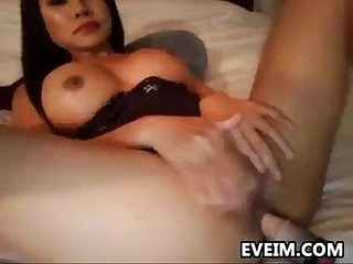 Asian milf masturbates with a toy