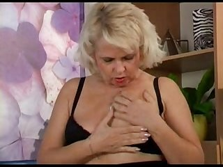 Blond mature's doing herself