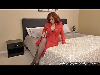 Redhead milf Andi James pleasures her mature pussy