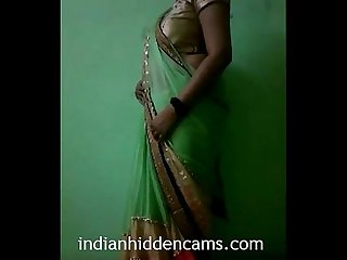 Indian Bhabhi in sari stripping naked indianhiddencams com