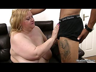 Busty plumper rides black cock