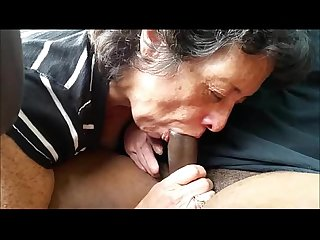 Mature lady sucks a black shaft