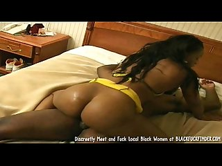 Black woman in yellow lingerie takes 2 cocks on the bed