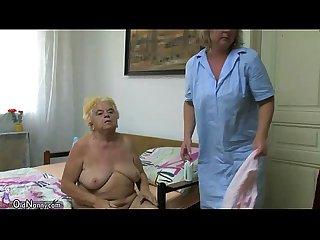 Mature woman using dildo on chubby granny