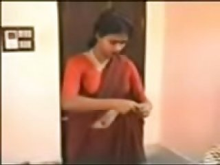 red saree lady removing dress and enjoying with young guy.3GP