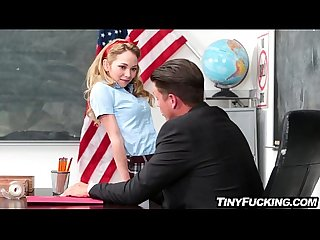 Petite blonde schoolgirl seduces her teacher fucks him on desk