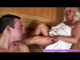Granny orally pleasured in sauna
