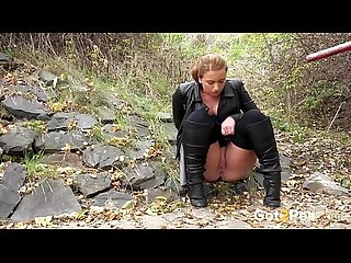 Curvaceous chick in leather pisses in the woods pissing porn