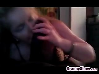 Grandma gives a blowjob to a big black cock