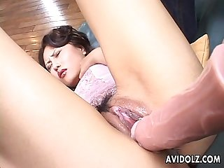 Lovely Japanese gal fingered and stuffed with a large dildo
