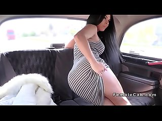 Sexy brunette showing body in fake taxi