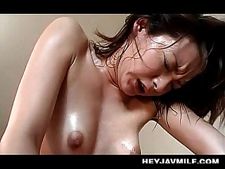 Sweaty asian mom jumping dick in her pussy like a real slut