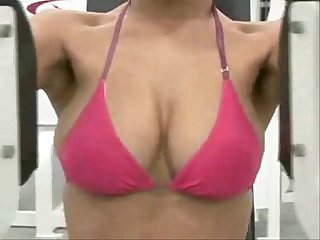 Hot busty asian girl working out