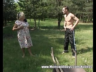 Fatty mature lady fucks young lad in the woods