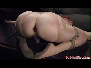 Flogged redhead with buttplug gets punished