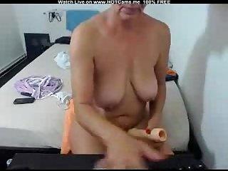 Amateur Busty granny dildoing hard