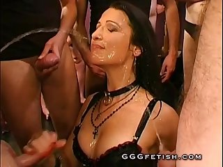 Group pissing on sexy brunette