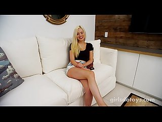 Natural busty blonde playing with toy on couch
