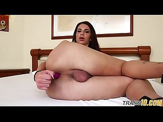 Busty solo babe tugging her fat cock