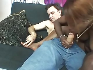 Black girl Destiny Lane rubs her feet all over the white guy's crotch