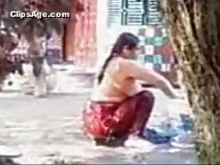 Aunty bathing outdoor