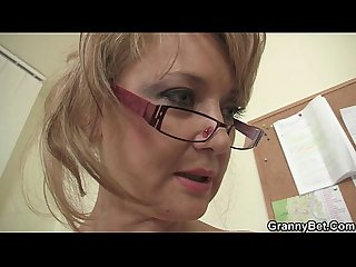 Office mature in white stockings riding his rod