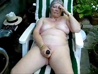 Pervert granny maturbating in court yard amateur older