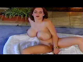 Busty girl masturbates her self to an orgasm