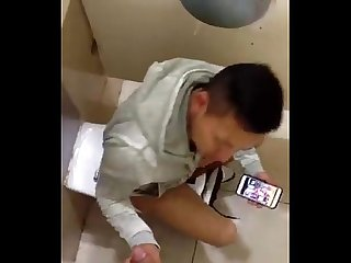 Chinese boy sucking cock in Toilet and selfie