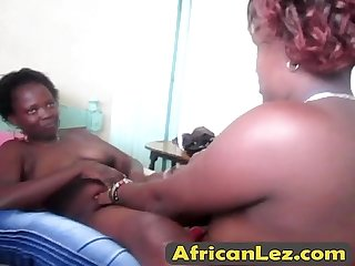 Ebony lesbians sexy bedroom action with toys