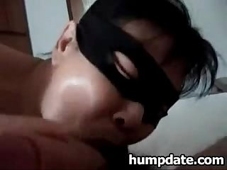 Asian wife wearing a Mask and sucks cock